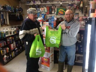 Randy Holwell (left) and Peter Dyson holds re-usable shopping bags at Gateway Convenience.