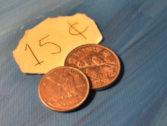 15 cents in coins and on paper.