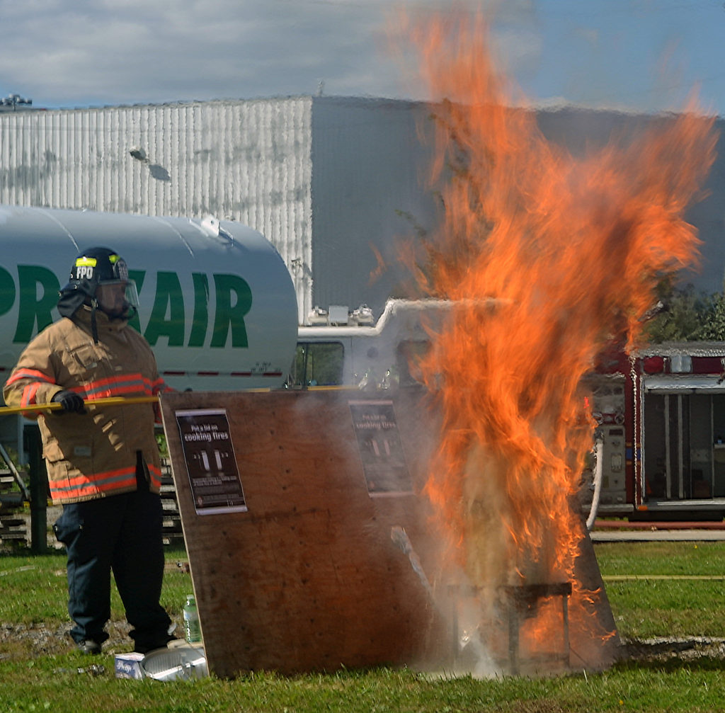 An outdoor turkey fryer bursts into flames, a common accident around Thanksgiving.  The demonstration was part of a kick-off to Fire Prevention Week.