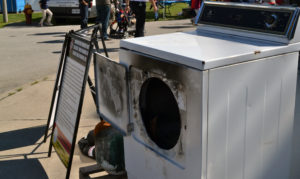 """alt=""""a clothes dryer burned by a house fire"""""""