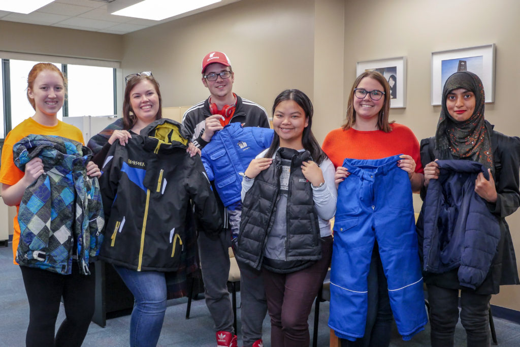 Memorial University students display some clothing they have collected as part of their Coats for Kids campaign.