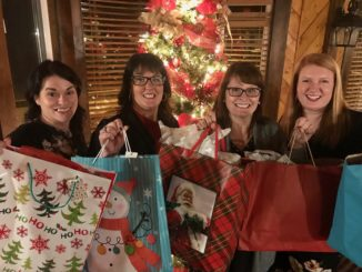 ladies holding gift bags
