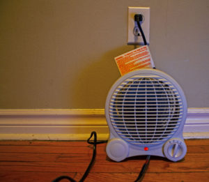 A space heater and manufacturer's instructions. Firefighters urge caution when using secondary heat sources