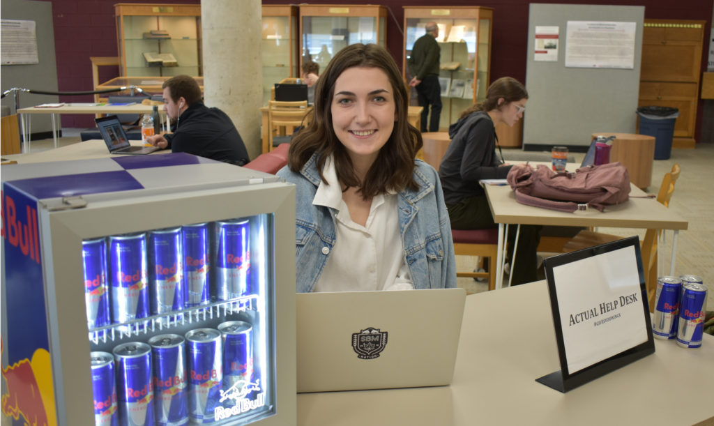 "Beth Smith is a third-year Memorial University of Newfoundland and Labrador (MUN) and marketer for Red Bull. Her fun marketing strategy is to set up an ""Actual Help Desk"" that will give students the energy they need for finals."