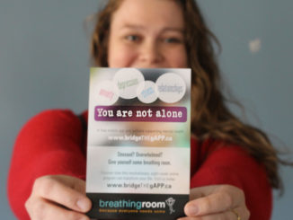 student with mental health helpline pamphlet
