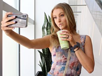 Local Instagram influencer Erin Kenny taking a selfie with her avocado smoothie.