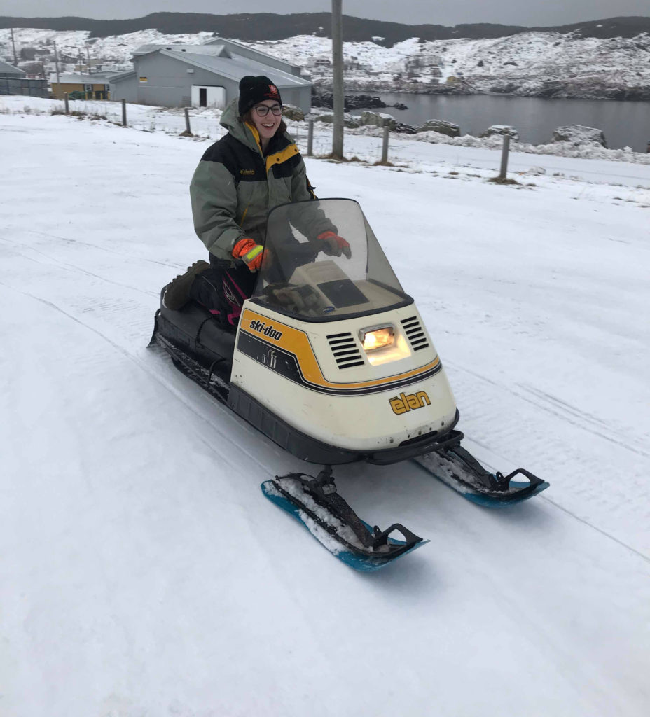 woman rides 1976 elan snowmobile