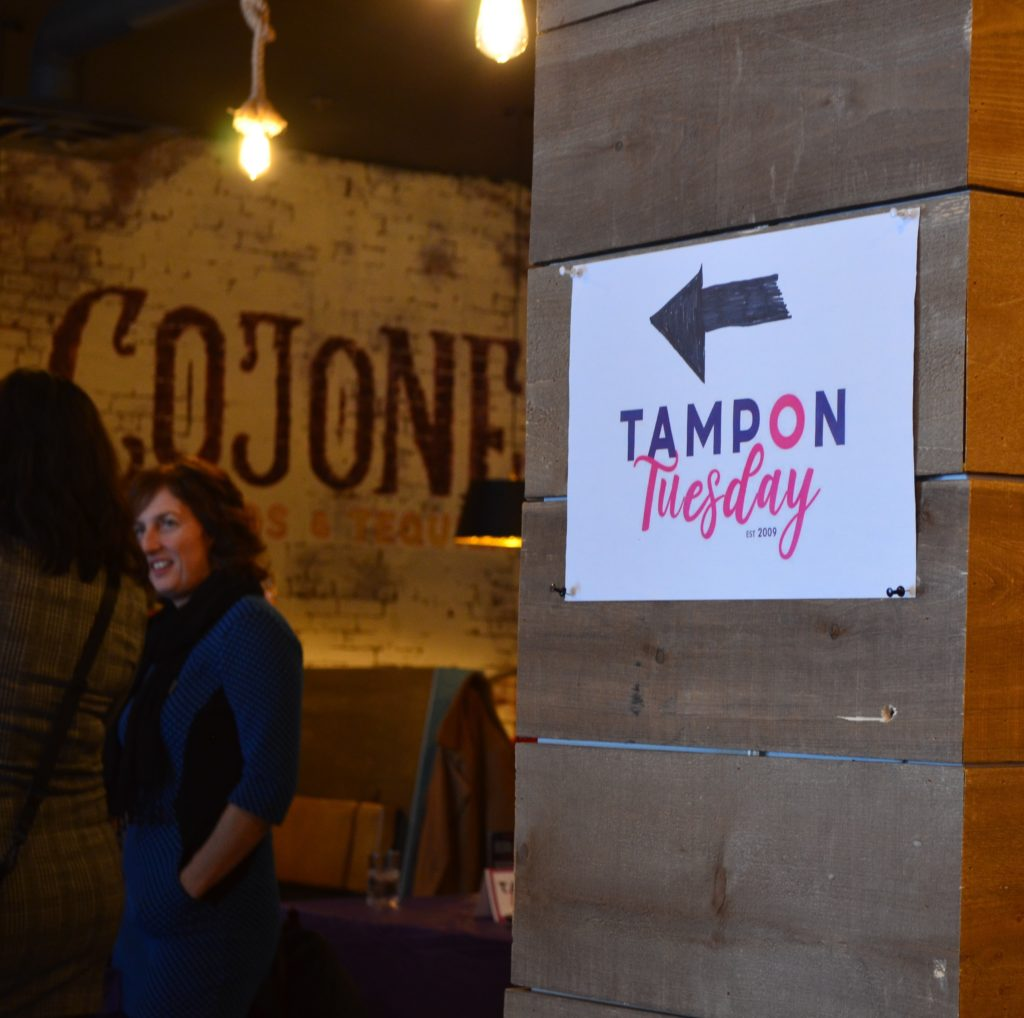 A sign directs attendees of Tampon Tuesday into the event at Cojones in St. John's, NL. Anna Murphy/ Kicker.