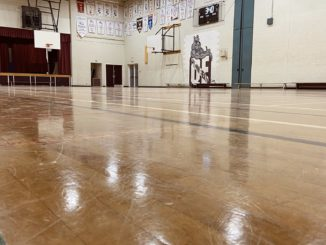This gym was supposed to be packed with the boy and girls basketball teams practicing for playoffs.
