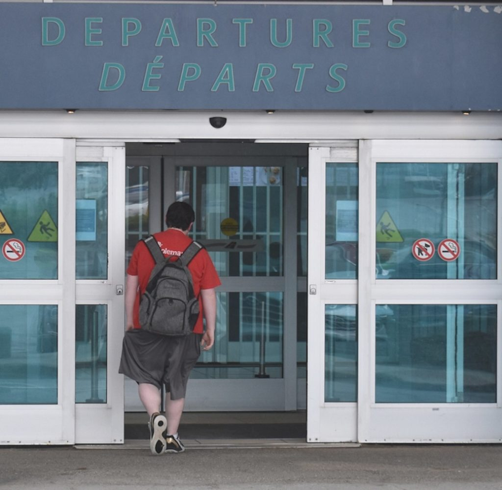 Person walking through departure gate at St. John's Airport
