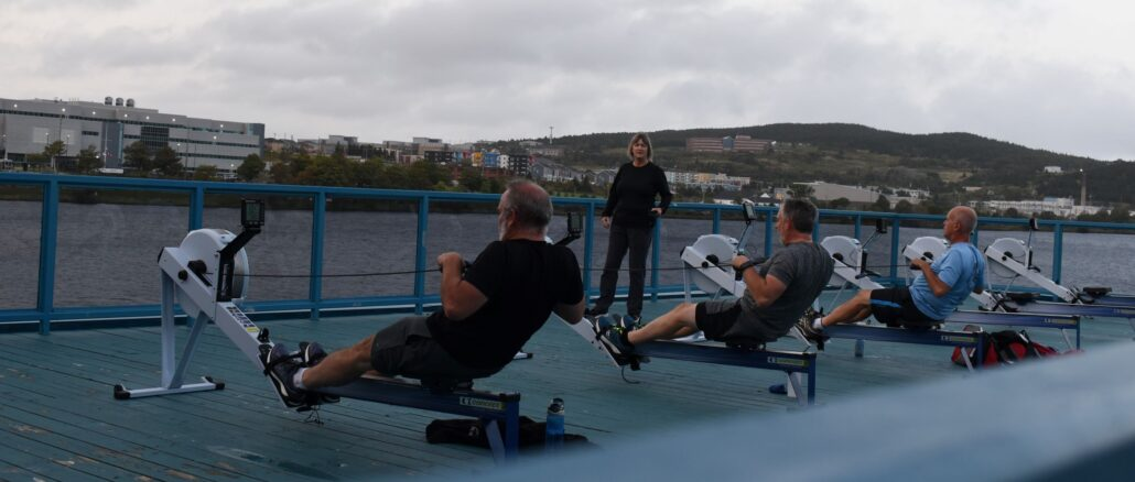 The deck on the Royal St. John's Regatta boathouse is now open and being used by rowers to train. Pictured here is coxswain Jackie Warfield and members of her team.