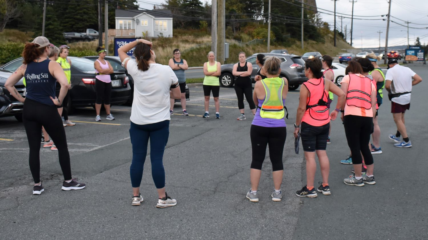 A group of runners from Sister's in Fitness stretch and prepare for a run. Most are training for the Cape to Cabot virtual race.