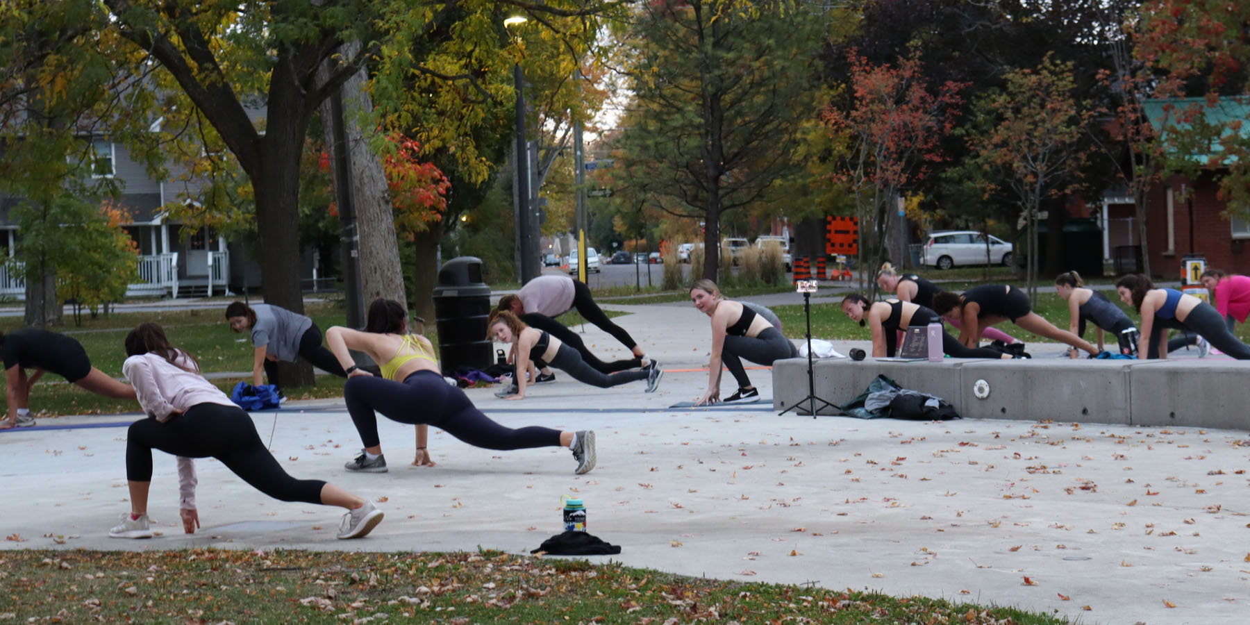 A group of young women workout in a public park in Kingston, Ontario. Alexis Pascoal is their instructor.