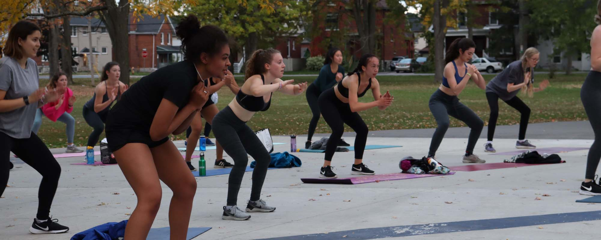 A group of women workout in public park in Kingston, Ontario.