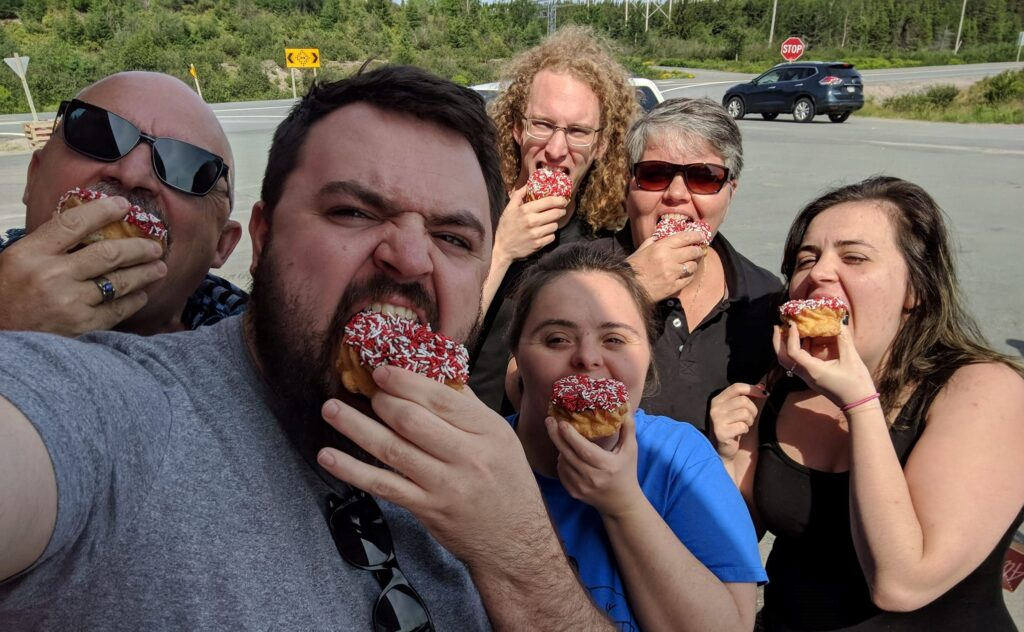 Sheila Bradbury and her family eating Special Olympics donuts.
