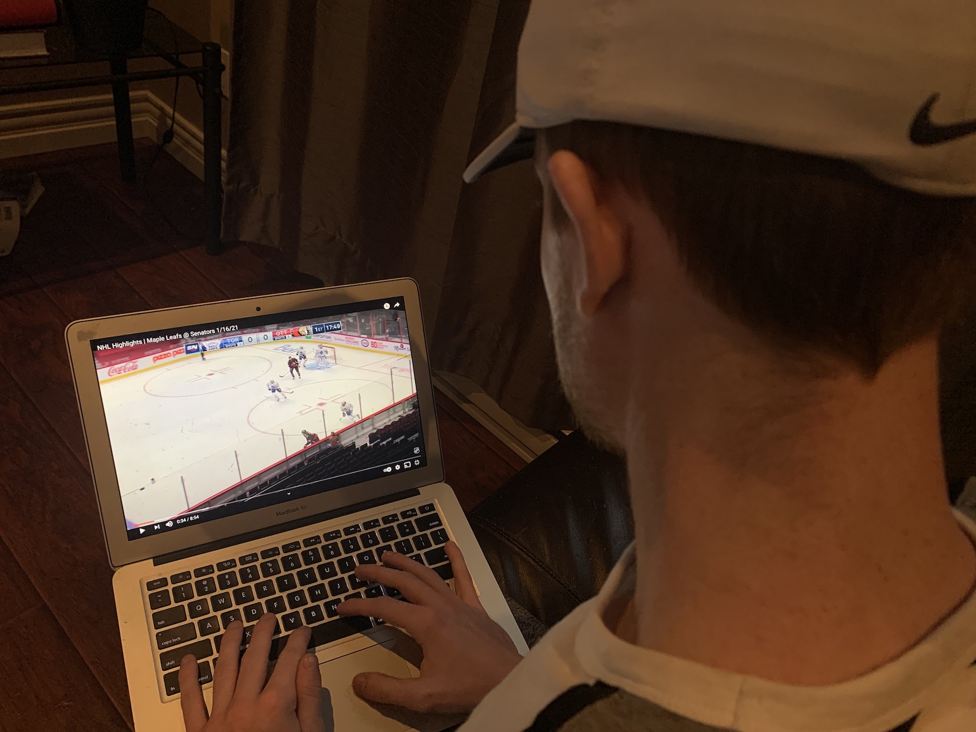 Person watches NHL on laptop