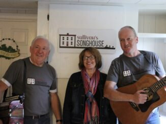 Songhouse owners with a happy fan