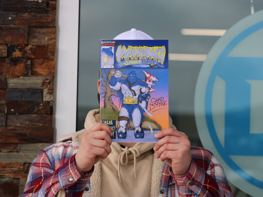 Outside of Timemasters' comic book store, a customer holds a copy of Byrne's comic up.