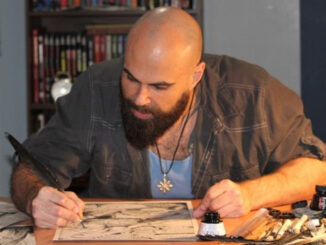 Chad Byrne, local comic writer and artist, working away at his desk.