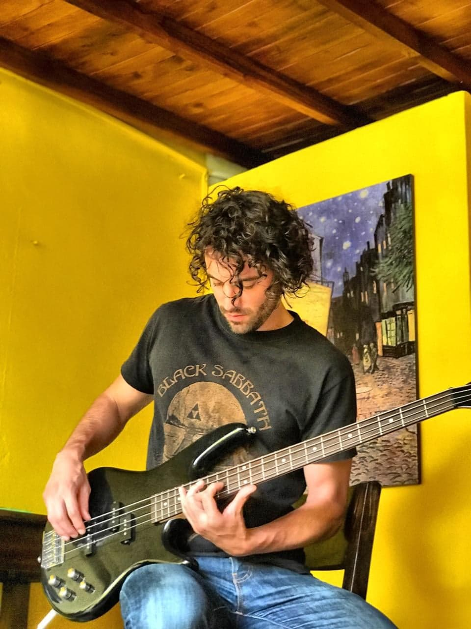 Francis Will plays bass at home in Newfoundland during lockdown, after returning from living in Montreal.