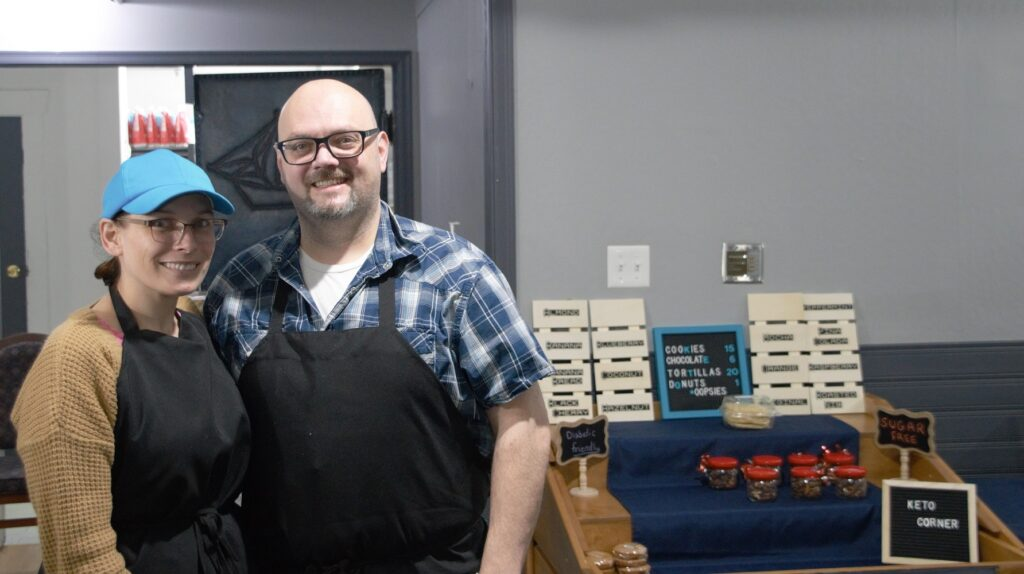 Christa and Walter Lundrigan stand in their restaurant next to their Keto Corner.