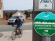 Bicyclist riding by a sign marking the T'railway
