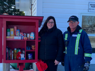 Megan and her father standing next to Jane's Pantry