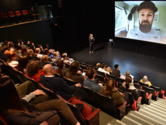 """The director of the file """"Design Canada"""", Greg Durrell is seen on the screen via Skype answering questions from the audience at the LSPU Hall in St. John's."""