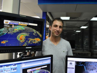 Eddie Sheerr generates his own forecasts when he forecasts the weather. He is at his desk keeping track of Hurricane Leslie in NTV headquarters.