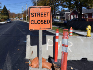 A road sign that reads street closed iin a residential neighbourhood