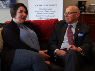 CHANNAL executive director Paula Corcoran sits with health minister John Haggie at the opening of the Mount Pearl location on Tuesday. A second Warm Line is now taking calls to help people facing mental health issues. Andrew Waterman/Kicker