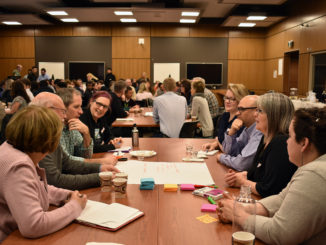 Participants of the Hacking Health Café event held at Memorial University's Faculty of Medicine discuss their ideas to lower no-show rates at Eastern Health. This Hacking Health Café event is the biggest turnout to date for the events.