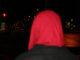 a woman wearinga red hijab looks down PPD sidewalks