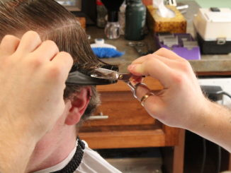 Jeremy Edgar gives a haircut at this downtown St. John's barbershop. He says everyone deserves a haircut, even if they cannot afford one.