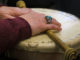 Marie Eastman's hands crossed over her personal drum, donned with hieroglyphs.