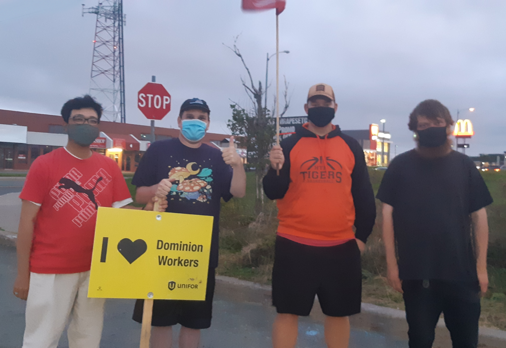 4 young men picket outside of a Stavanger Drive Dominion