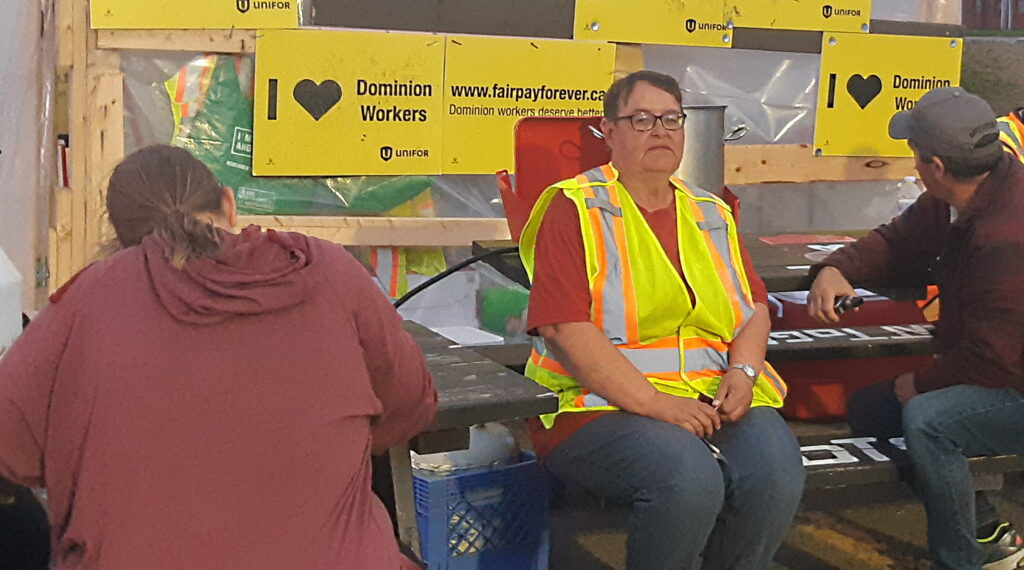 strikers with dominion sit on the picket line