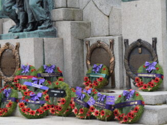 wreaths are laid at the foot of the war memorial in St. John's