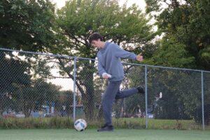 Man Kicking a Ball